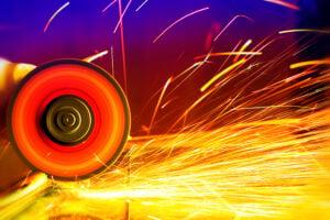 Sparks from circular saw. Metal sawing close up.
